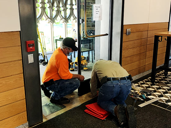 commercial door installation by 2 service people of Horton Automatics of Ontario