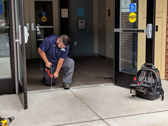 commercial door repair being done by Horton Automatics of Ontario