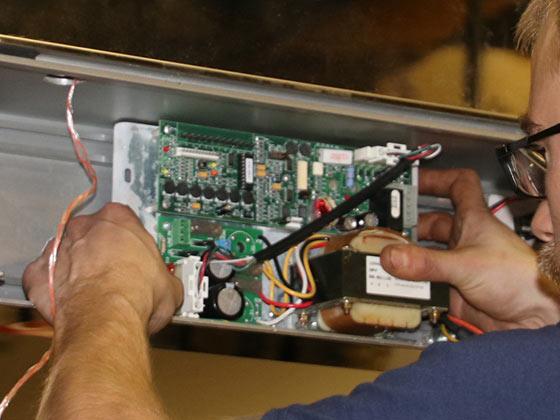 Door maintenance contracts service person fixing automatic door Horton
