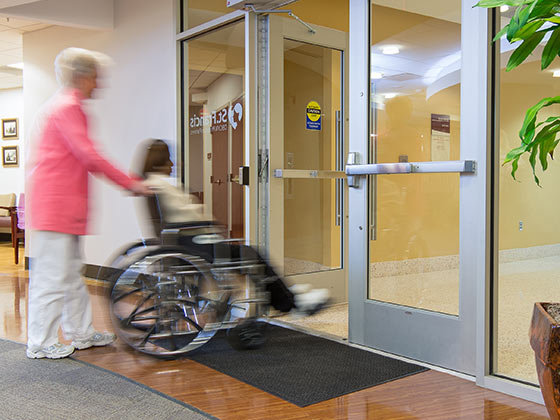 hands-free door opener in action from Horton Automatics of Ontario